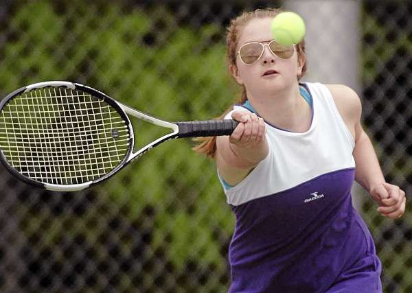 Hampden Academy's Rachel Henderson returns the ball during the Eastern Maine Class A quarterfinal team tennis match held on Friday, June 3, 2011, at Brewer.