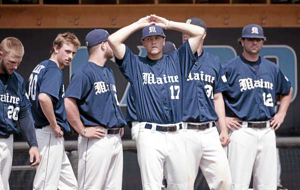 Maine's Stephen Perakslis (17) and his teammates react after the Black Bears' 5-2 loss to James Madison on Sunday June 5, 2011 at Boshamer Stadium in Chapel Hill, N.C.