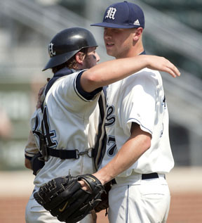 Maine catcher Tyler Patzalek (34) embraces pitcher Stephen Perakslis (17) after closing out the ninth inning with a 4-1 victory over Florida International University on Saturday June 4, 2011 at Boshamer Stadium in the NCAA Chapel Hill Regional in Chapel Hill, N.C. Both players are sophomores and will return to play for the Bears next season.