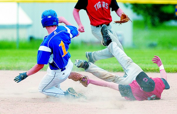 Hermon High School's Jared Cox (left) is tagged out by Gardiner High School's Josh Ouellette at second base during the fifth inning of their Eastern Maine Class B prelim at the Hermon High School field Tuesday. Hermon won 1-0.
