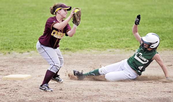 Old Town's Meagan Cousins slides around Caribou's Sare Damboise to steal second during the third inning of their Eastern Maine Class B semifinal at Old Town High School Saturday afternoon, June 11, 2011. Caribou won 4-2 in nine innings.