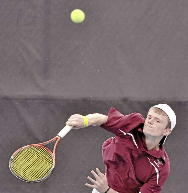 Ellsworth's Dustin Murphy serves in doubles competition against Falmouth Saturday during the Class B state team tennis final at Colby College in Waterville. Falmouth's Connor Burfeind and Tom Wieberg defeated Ellsworth's Murphy and Luc Victory and Falmouth also captured the team title 5-0.