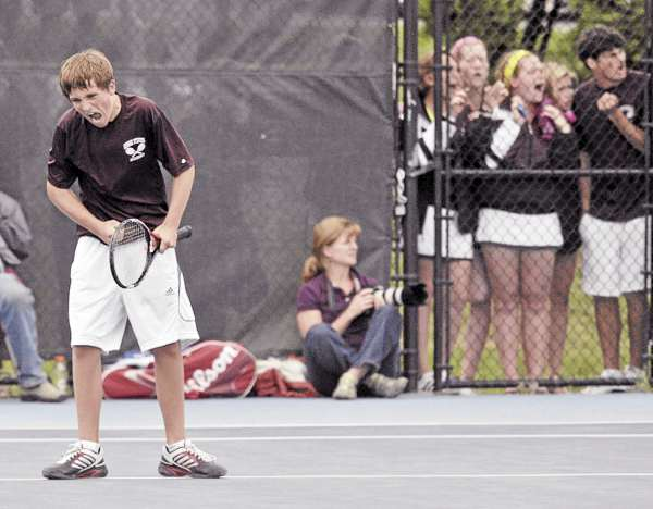 With his teammates at the door watching the shots, GSA's Alexander Heilner reacts after he wins a point in his Class C state team tennis match against Waynflete's Ben Shapiro. Shapiro went on to win the match 5-7, 6-3, 7-5 and Waynflete won the team crown 3-2.