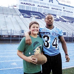 From Maine to Ghana, former UMaine football player shares passion for teaching children