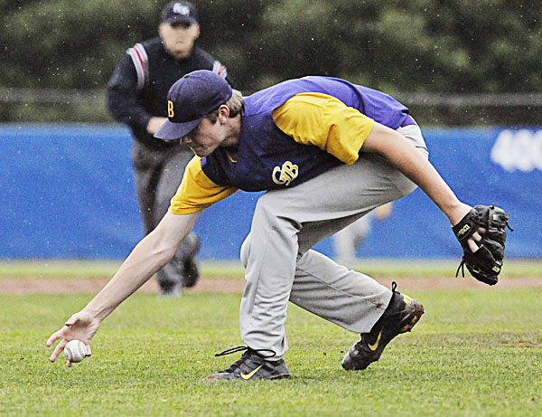 Bucksport pitcher Evan Eldridge grabs a ground ball from in front of the mound in the first inning of their game against Waterville in the Eastern Maine Class B final Tuesday at Mansfield Stadium in Bangor. Waterville won 10-0 in five innings.