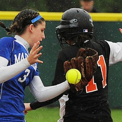 Deer Isle-Stonington shortstop Janelle Ciomei misses a tag on Ashland's Amanda Paradis at second base during the fifth inning of their Eastern Maine Class D final at Coffin Field in Brewer Tuesday. DI-Stonington won 28-2.