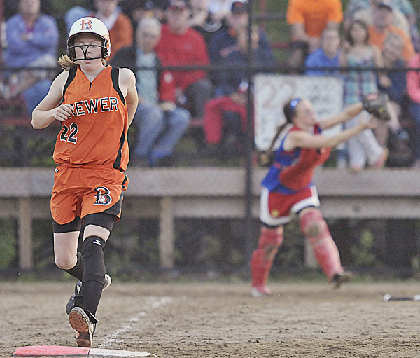 Brewer's Morgan Small (left) just gets to first base as Messalonskee catcher Alyssa Eugley makes the catch on Small's pop fly in the fifth inning of their Eastern Maine Class A softball title game Wednesday in Augusta. Messalonskee shut out Brewer 6-0.