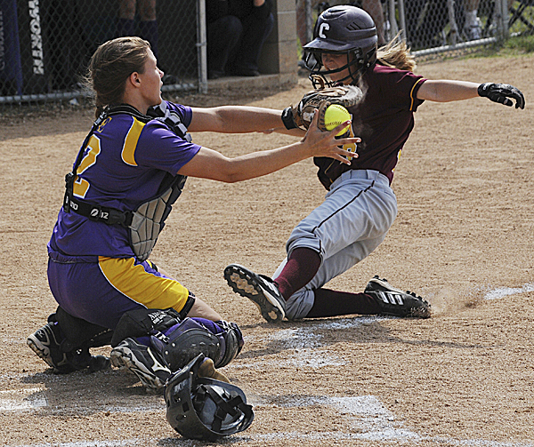 Bucksport catcher Mindy Pye blocks the plate and tags out Caribou's Jamie Martin during second-inning action of their Eastern Maine Class B final Wednesday at Coffin Field in Brewer. Bucksport defeated Caribou 2-1.