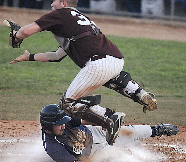 Calais High School's Jeremy Beers gets to home plate under Foxcroft Academy catcher Cody Coiley to score a run in the third inning of their Class C  Eastern Maine baseball final at Mansfield Stadium in Bangor Wednesday evening, June 15, 2011.