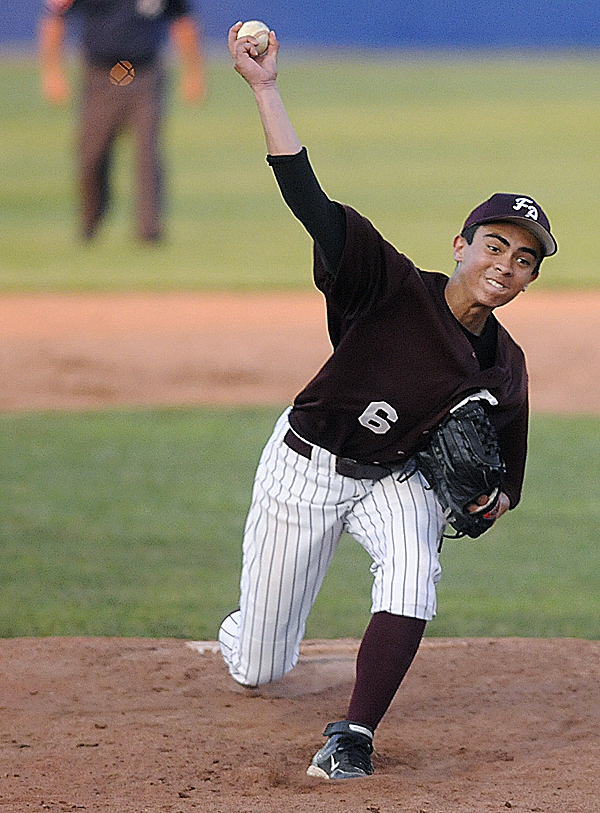 Foxcroft Academy pitcher Ryan Rebar pitches in the third inning of the Class C  Eastern Maine baseball final against Calais High School at Mansfield Stadium in Bangor Wednesday evening, June 15, 2011.
