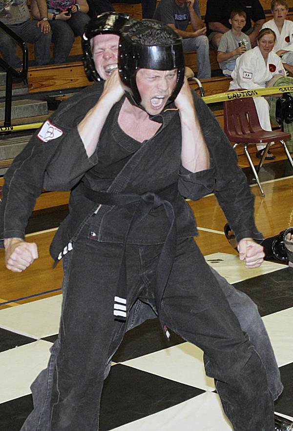 Jay Peavey and Jarrod Kingsbury perform their ju-jitsu routine at the 20th annual Graves Summer Kick off Karate and Ju-Jitsu Tournament last week in Houlton.