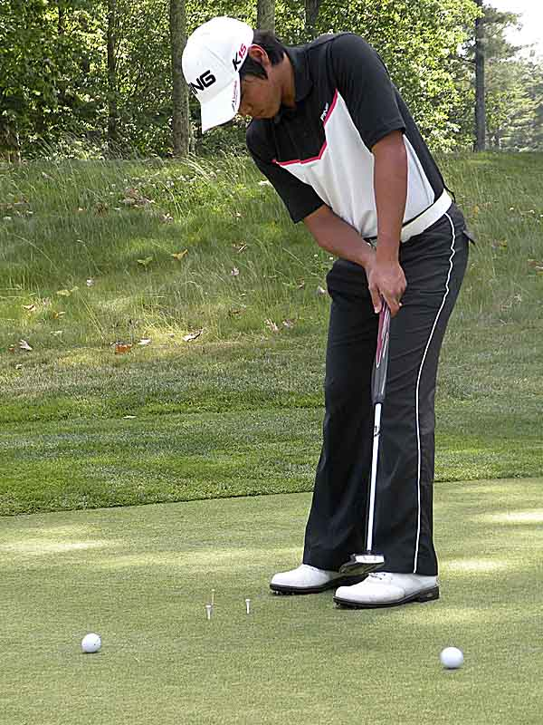 Beon Yeong Lee of Cote-St-Luc, Quebec, practices his putting at Falmouth Country Club after the opening round of the 93rd Maine Open Golf Championship on Tuesday, June 21, 2011. Lee is tied for the lead with Falmouth assistant pro Shawn Warren at 6-under-par-66.