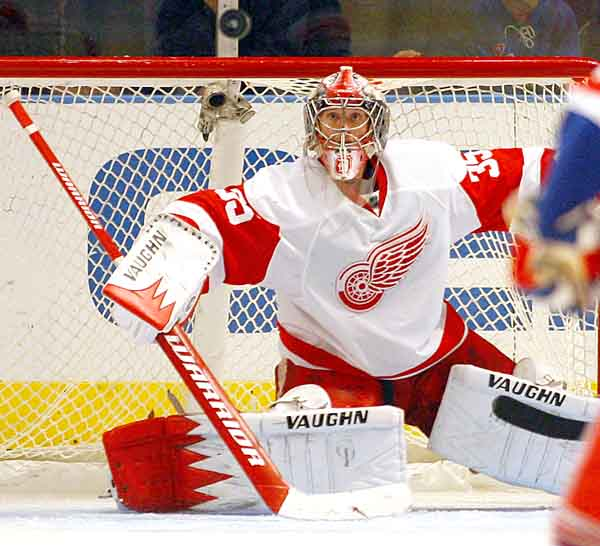 Goalie Jimmy Howard of the Detroit Red Wings makes a save during a game in 2009. The former University of Maine standout is being inducted into the school's hall of fame this fall.