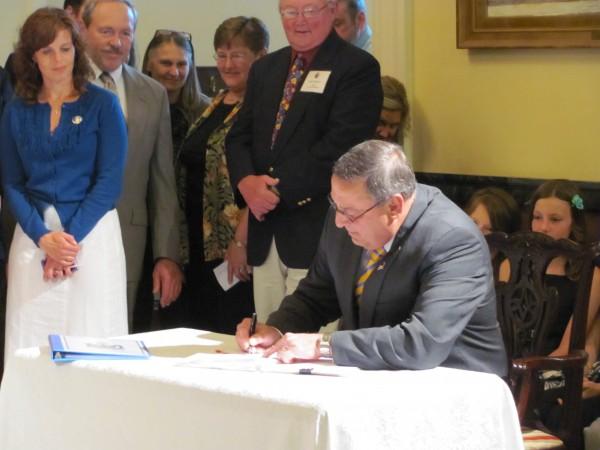 Gov. Paul LePage signs a bill Wednesday, June 29, 2011, that will allow charter schools in Maine. LePage said Maine is now the 41st state with a charter school bill on the books.