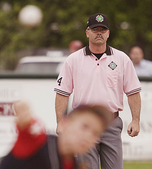 Bangor District 3 umpire Troy Lare monitors the action from second base during an all-star game in Bangor Thursday.