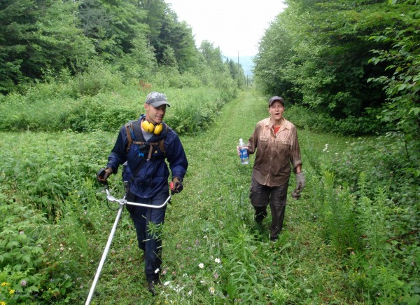 Chad McPherson and Julie Daigle helping on trail clearing last summer at 10th Mtn.