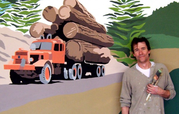 Chez Cherry stands next to his mural of famous Maine landmarks at the Maine Jump in June, 2011.