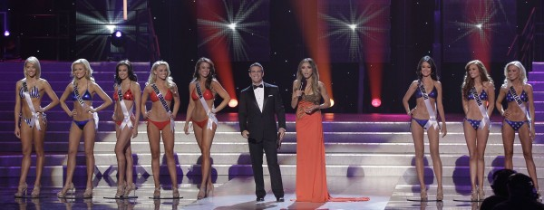 Miss USA hosts Andy Cohen (left center) and Giuliana Rancic introduce the semifinalists during the 2011 Miss USA pageant, Sunday, June 19, 2011, in Las Vegas. From left, they are Miss Maine, Miss Tennessee, Miss Texas, Miss South Carolina, Miss Alabama, Miss Hawaii, Miss California and Miss Maryland.