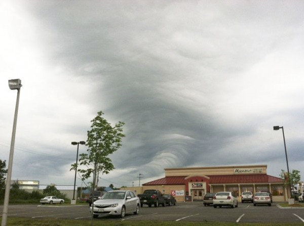A cylindrical formation of clouds is seen near Stillwater Avenue in Bangor before 7 p.m. Thursday, June 9, 2011. Severe weather wreaked havoc on the region Thursday.
