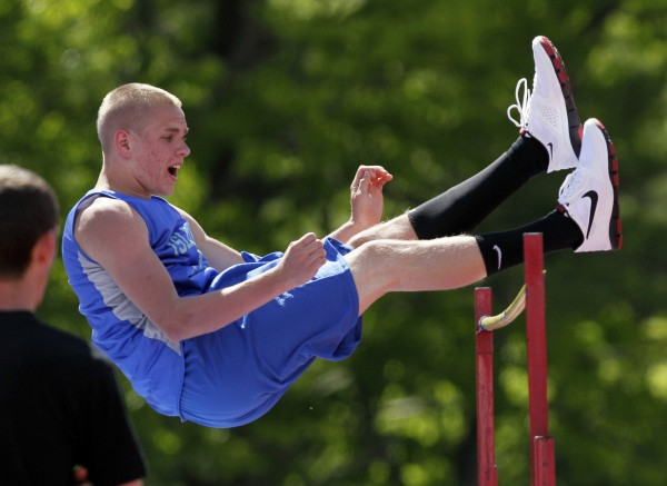 Islesboro's Gerard Scherr clears the bar during the high jump competition at the Class C Track and Field Championships at McMann Field in Bath, Maine, Saturday, June 4, 2011.