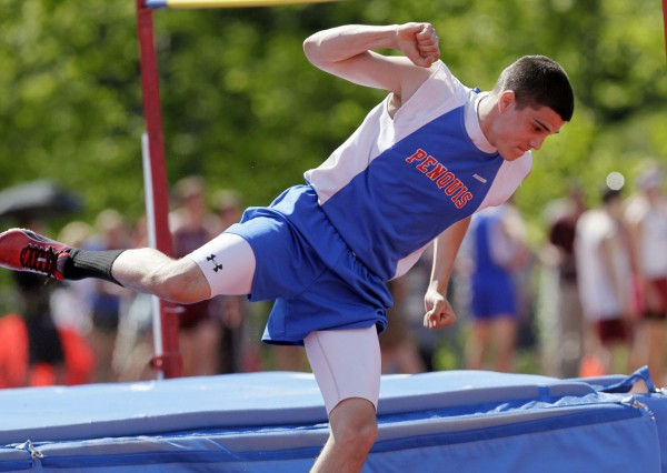 Penquis' Emery Shane celebrates after successfully clearing 5-feet 10-inches in the high jump competition at the Class C Track and Field Championships at McMann Field in Bath, Maine, Saturday, June 4, 2011.