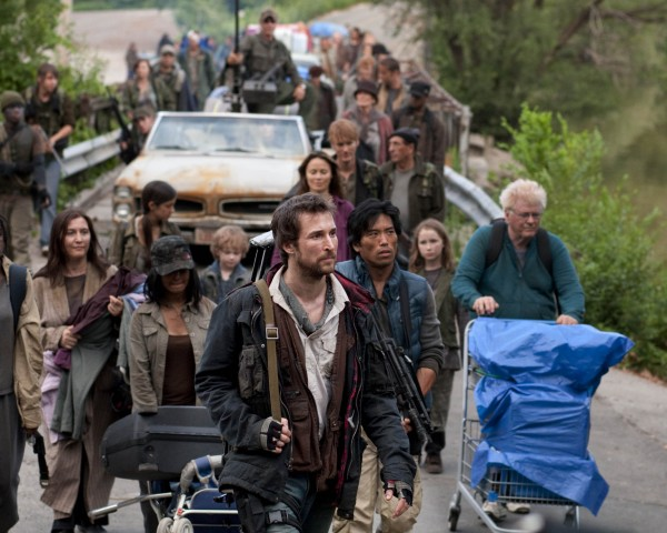 "In this publicity image released by TNT, Noah Wyle, center, is shown in a scene from the new TNT sci-fi series ""Falling Skies.""  Wyle portrays Tom Mason, who is second-in-command of a ragtag regiment of survivors in the ravaged Boston area."