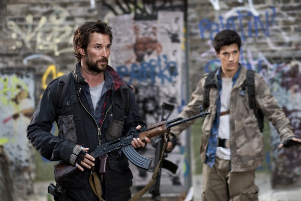 "This image released by TNT shows Noah Wyle and Drew Roy in a scene from the new TNT sci-fi series ""Falling Skies,"" which premieres Sunday, June 19, 2011, at 9 p.m. EDT."