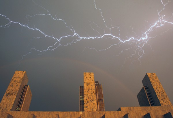 Lightning and a forming rainbow are seen over the state agency buildings at the Empire State Plaza in Albany, N.Y., on Wednesday, June 8, 2011.