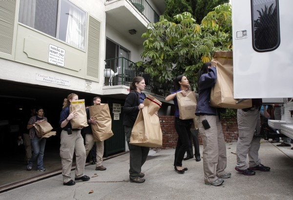 "FBI agents load evidence bags into a truck outside an apartment complex where fugitive crime boss James ""Whitey"" Bulger and his longtime companion Catherine Greig were arrested in Santa Monica, Calif., Thursday, June 23, 2011. The Boston mob boss was captured near Los Angeles after 16 years on the run that embarrassed the FBI and exposed the bureau's corrupt relationship with its underworld informants."