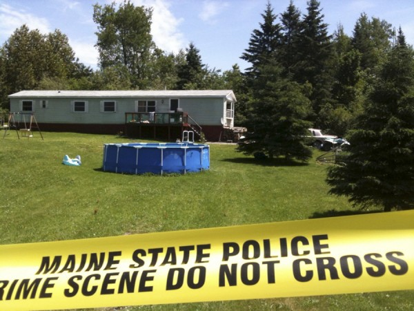 In June 2010, crime tape surrounded the site as members of the Maine State Police Evidence Response Team continued to look for clues at the Amity home where two men and a boy were stabbed to death.