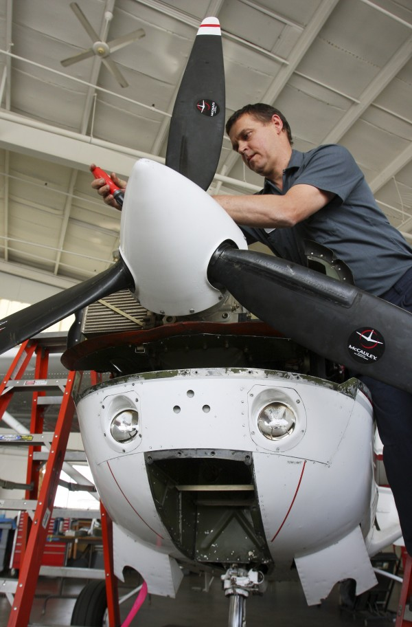 Aircraft mechanic Will Andrews of Windham works on a plane at Northeast Air in Portland on Wednesday, June 22, 2011. Aviation companies are applauding a new law that eliminates sales taxes on aircraft sales and parts starting July 1. Plane enthusiasts say business should grow now that Maine is on equal footing with other New England states that have similar tax exemptions.