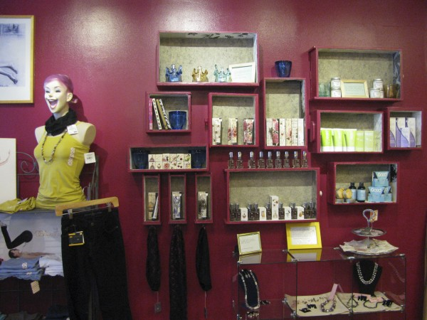 A wall at City Drawers, a new underwear store on Main Street in Belfast, displays perfumes and accessories for sale. The shop is one of more than 40 that have opened or expanded in Belfast in the last year.