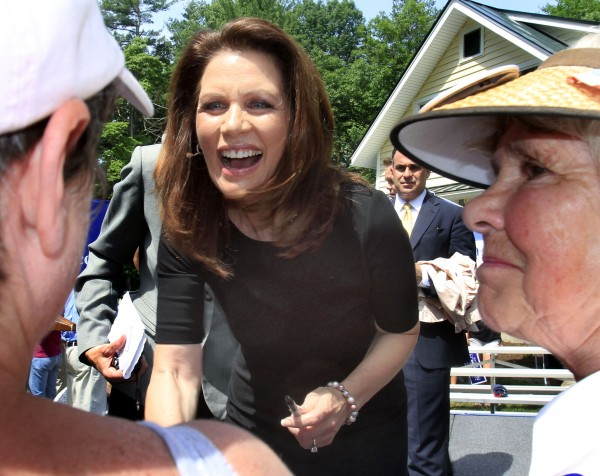 Republican presidential candidate, Rep. Michele Bachmann, R-Minn., talks with supporters during a campaign stop in Raymond, N.H., Tuesday, June 28, 2011.