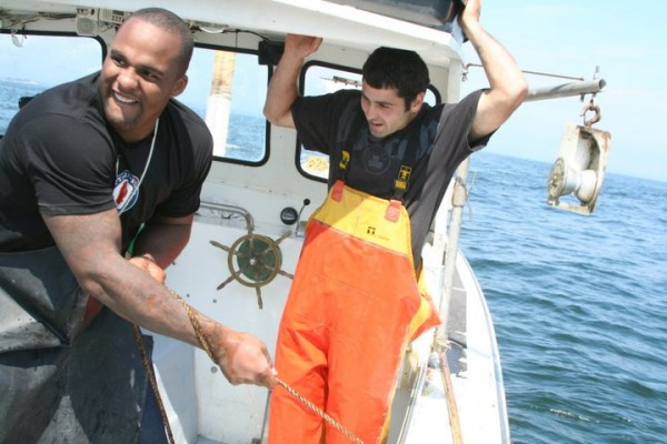 "Boston Celtics forward Glen ""Big Baby"" Davis, left, hauls traps with Phippsburg-based lobsterman Richard Gilmore on Saturday as part of a promotion for GetMaineLobster.com."