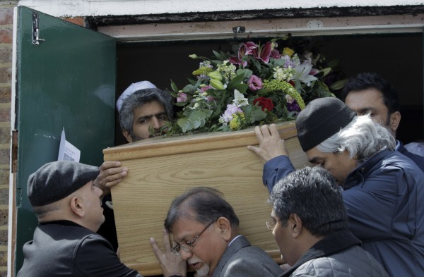 Mourners carry the coffin of Indian painter Maqbool Fida Husain during his funeral procession in south London, Friday, June 10, 2011. M.F. Husain's paintings and even his simple pencil drawings became status symbols for India's wealthy elite, with his works commanding price tags running into millions of US dollars. M.F. Husain, as he was known, often described as India's Picasso,was a former movie billboard artist who rose to become India's most sought-after painter before going into self-imposed exile during an uproar over nude images of Hindu icons. He was 95.