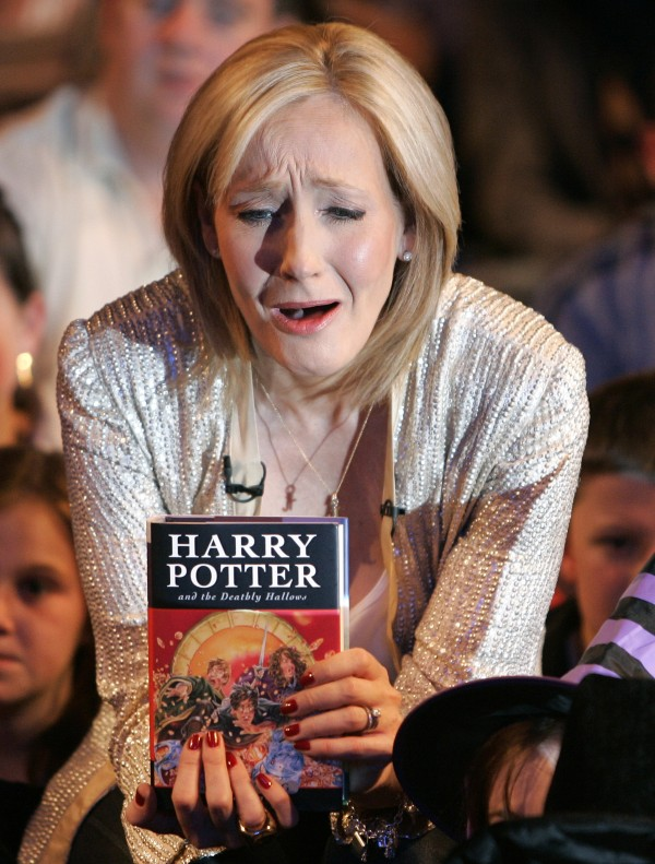 In this Friday, July 20, 2007 file picture British author J.K. Rowling reacts during a photocall for the release of her latest Harry Potter book titled &quotHarry Potter and the Deathly Hallows&quot at the Natural History Museum in London.Harry Potter fans are holding their collective breath as author J.K. Rowling gets set to reveal her latest project involving the boy wizard. Rowling has called a news conference Thursday in London to reveal details of &quotPottermore,&quot a mysterious website that has been taunting fans with the words &quotcoming soon.&quot