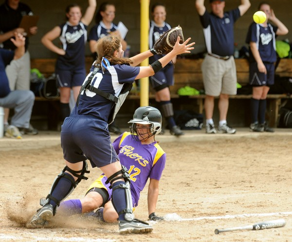 Bucksport High School's Mindy Pie (right) slides to the plate as Fryeburg Academy's  catcher Carla Tripp waits for the late throw during the third inning of the game in Standish Saturday afternoon.  Fryeburg Academy won the Class B Softball State Championship game 5-2.