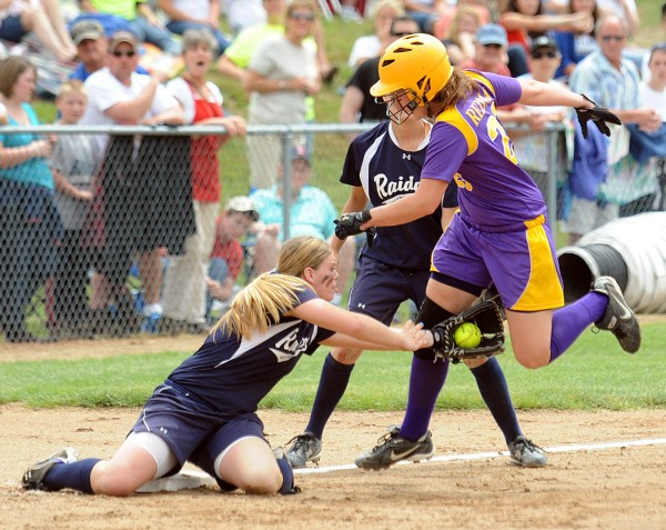 Bucksport High School's Shelby Redman (right) is taged by Fryeburg Academy's   Maggie McConkey during the third inning of the game in Standish Saturday afternoon.  Fryeburg Academy won the Class B Softball State Championship game 5-2.