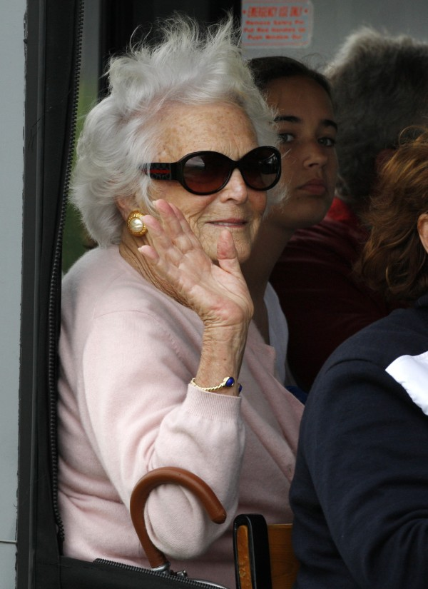 Former first lady Barbara Bush waves to spectators while riding in a trolley before watching her husband, former U.S. President George H. W. Bush, celebrate his 85th birthday, June 12, 2009, in Kennebunkport. Barbara Bush will celebrate her 86th birthday by reading to young patients at The Barbara Bush Children's Hospital at the Maine Medical Center in Portland on Wednesday.