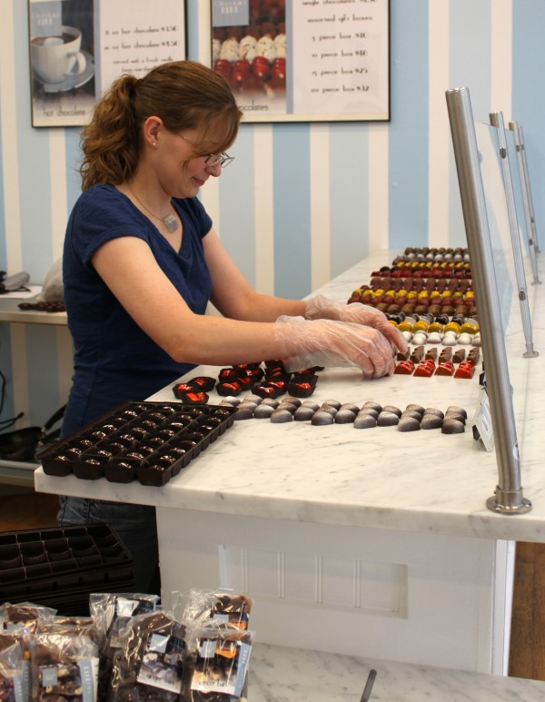 Jessica Steeve organizes rows of chocolate truffles at Chocolatier Blue in Camden.