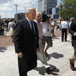 "Former Massachusetts Senate President William Bulger, center, is followed by members of the media as he arrives at federal court before a scheduled appearance at the court by his brother James ""Whitey"" Bulger, in Boston, Thursday, June 30, 2011. James ""Whitey"" Bulger was arrested last week in Santa Monica, Calif., after 16 years as a fugitive."
