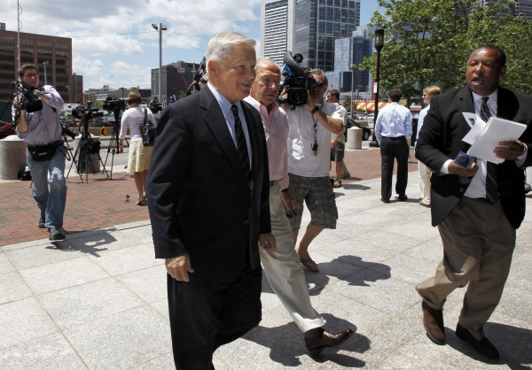 Former Massachusetts Senate President William Bulger, center, is followed by members of the media as he arrives at federal court before a scheduled appearance at the court by his brother James &quotWhitey&quot Bulger, in Boston, Thursday, June 30, 2011. James &quotWhitey&quot Bulger was arrested last week in Santa Monica, Calif., after 16 years as a fugitive.