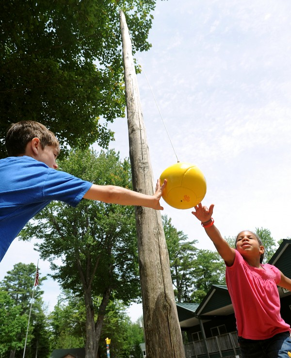 Joshua Hart, 9, of Brewer (left) and Makayla Lewis, 6, of Sanford play tetherball at Camp Rainbow in Ellsworth on Tuesday. They were among the 45 people who attend the week long Camp Rainbow that provides a free week-long summer camp for children diagnosed with cancer and their families. This is the 24th annual camp that is offered by the American Cancer Society.