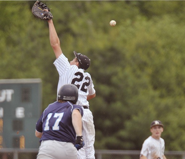 Calais' Jesse Clark (17) beats out an errant throw to first in the third inning for a single against St. Dom's Saturday, June 18, 2011.