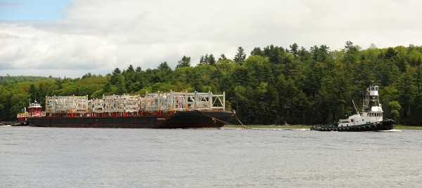 A shipment of modules that was made at the Cianbro Corp. Brewer facility pass through Winterport as it is guided down the Penobscot River by two tug boats Friday morning.