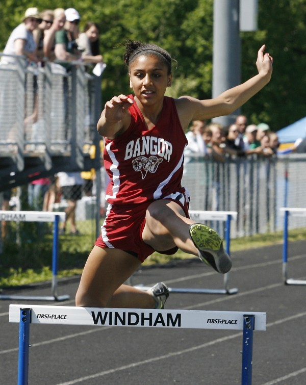 Bangor's Denae Johnson bumps a hurdle Saturday June 4, 2011 during the 300 meter intermediate hurdles at the Class A Track and Field Championships in Windham, Maine. Johnson finished fifth with a time of 48.61 seconds.