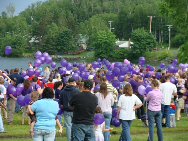 More than hundred people attended a gathering Saturday at the Lake Wassookeag public beach for domestic violence awareness. Purple balloons were launched by the attendees in remembrance of Amy, Coty and Monica Lake who were murdered by Amy's husband Steven Lake, the father of their children.