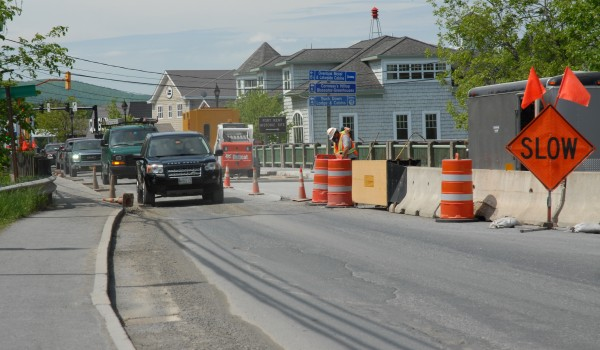 Traffic across the Fish River Bridge in Fort Kent is reduced to one lane as Maine DOT crews work to complete a re-decking of the structure's concrete surface.