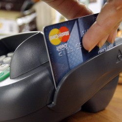 The debit card swipe: who should be helped?
