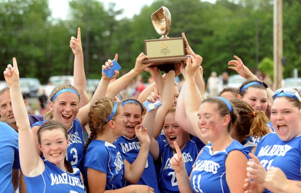 Deer Isle-Stonington High School's team celebrates their Class D State Softball Championship after defeating Richmond Regional High School 7-2 in Standish Saturday afternoon.